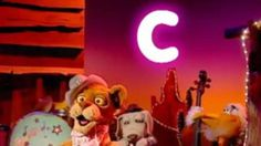 "(Two c sounds) In this video segment from Between the Lions, Tammy Lionette (Cleo) sings about the two sounds made by the letter ""c."" Words that appear on screen include: cry, certainly, card, crate, celebrate, call, cell, city, cycle, December, clear, nicely, crack, circus, camp, center, cramp, circles, crying, can, concede, cope, can't, and conceive. The letter ""c"" is in a different color and is colored regardless of where it appears in the word."