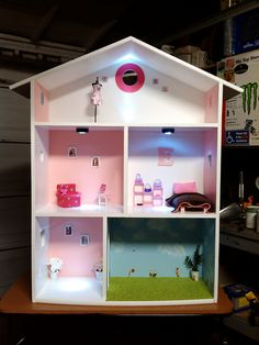 Doll House made by my husband and I. Bed, chair, lamp, table...all handmade too!