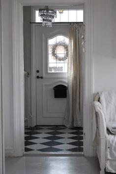 front door - love the curtain on it