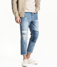 Light denim blue. 5-pocket, ankle-length jeans in washed denim with heavily distressed details. Regular waist, dropped gusset, and straight legs.