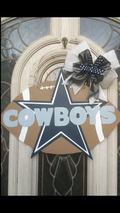 """Dallas Cowboys door hanger. Hangs 18"""". Sold with or without bow."""