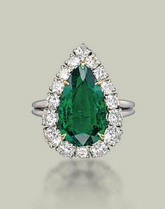 AN EMERALD AND DIAMOND RING, BY HARRY WINSTON  Set with a pear-shaped emerald in a brilliant-cut diamond surround, mounted in platinum, ring size 7 with ring sizer With maker's mark of Jacques Timey (indistinct) for Harry Winston