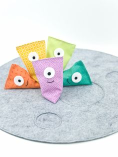 Help some friendly aliens make it to the moon in this easy-sew beanbag game!