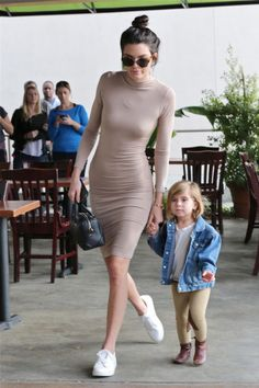 In a skin-tight turtleneck dress, white sneakers and her mini Givenchy bag while out with Penelope Disick in Calabassas.