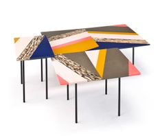 Fishbone tables by Patricia Urquiola for Moroso
