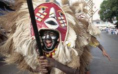 Dancer in elaborate headdress performs at the Ati-Atihan Festival in downtown Kalibo, Philippines.
