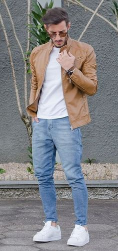 Tan leather jacket with white tshirt and light blue jeans