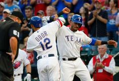 Texas Rangers' Rougned Odor (12) and Ian Desmond, right, celebrate a two-run…
