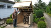 Man in front of wood shelter for bicycles 4 Shop Organizing Projects - Blade Storage, Battery Charging System, Storage Racks I find that by forcing yo. Pick A Random Number, Shelter, Metal Shelving Units, Build A Bike, Timber Roof, Bike Storage, Storage Racks, Garden Steps, Wood