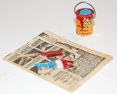Inspiration for the dollhouse workshop (Note: vintage paint can printies etc. pinned to my Attic Board, Evelyn   Source: Ruby Lane Antiques
