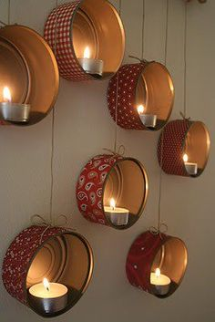old tins with tealights inside hung up with twine run through a small drilled hole. Perfect for an evening on the porch.