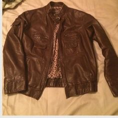 Brown faux leather jacket Moto style Excellent condition dark brown faux leather Moto style jacket. This jacket looks great with dresses, jeans, basically anything. Material looks very nice and is soft like real leather, animal print lining. Size medium runs true to size. Jackets & Coats
