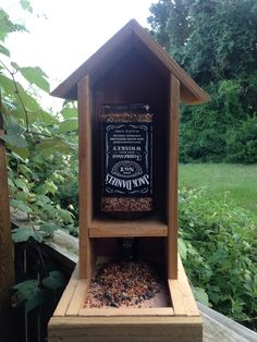 Jack Daniels whiskey bottle bird feeder