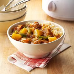 Slow Cooker Sweet-and-Sour Pork Recipe -Chinese food is a big temptation for us, so I lightened up a favorite takeout dish. As the pork cooks, the aroma is beyond mouthwatering. —Elyse Ellis, Layton, UT