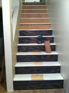 We bought MDF stairs and plywood treads.  Brady took 8 hours to cut, paint and install everything.