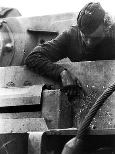 A German Tiger tank crewman checks out the enemy's shell damage (WW2 Photos - Page 42)