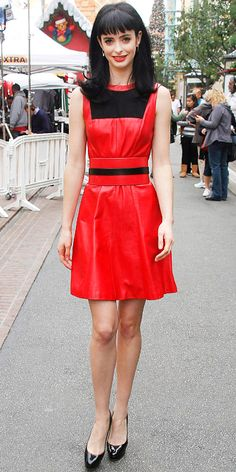 Krysten Ritter stopped by Extra in a red leather dress and platform Jimmy Choo pumps.