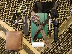 "Bison hide wallet Carabiner w/ keys and a micro-LED light Camillus 8.25"" Titanium Nitride coated VG-10 tanto folder Moleskine notebook Citizen H500-S062519 200m chronograph Benchmade Mini-Griptillian (Mel Pardue) in D2 tool steel Ruger LCP (.380 auto) w/ Uncle Mikes pocket holster Foray 1.2mm retractable ballpoint Cyclops high intensity light Bic lighter 40"" Desert shemagh [[MORE]]  What a great website! Find our speedloader now! http://www.amazon.com/shops/raeind"