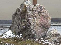 Beautiful rock with snow, in Royoanji Temple Garden.