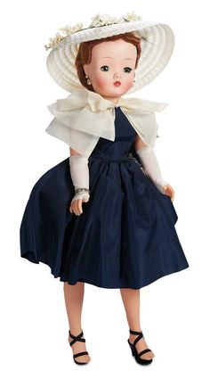 """Cissy in Polished Cotton Aqua Dress by Alexander,1957  20"""" (51 cm.) Hard plastic socket head,torso and legs with jointing at hips and knees,rigid vinyl arms jointed at shoulders and elbows,blue sleep eyes,lashes,closed mouth with rd lips,tosca curly hair and bangs."""