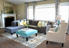 The Family Room: Budget Friendly Family Room - Bringing color into a neutral painted/carpeted room.