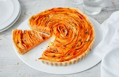 For a savoury treat, try this delicate rose-shaped tart made with sweet potato, thyme and Parmesan. Find more sweet potato recipes at Tesco Real Food.