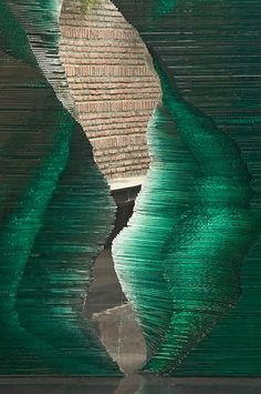 Delhi, India - Danny Lane Sculpture. Two twisting stacks of glass stand between two wings of a house in Delhi. The piece is titled Shyam.