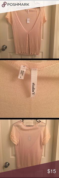 Short Sleeve Cardigan NWT. Very light short sleeve cardigan. Has ruffles on both sleeves. From Maurice's. Tops