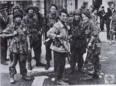 French SAS commandos and local FFI meet in September 1944.