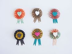 How to make cut paper Valentine's Day rosettes at Handmade Charlotte. Our kids would love these!
