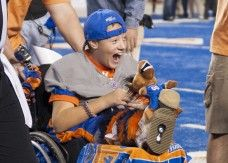 Make-A-Wish recipient Shane Swanson expresses his excitement during the coin toss at the start of the Sept. 28 Boise State football game against Southern Mississippi University.
