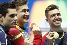 Gold medallist USA's Anthony Ervin (C) poses with silver medallist France's…