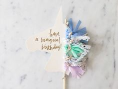 Design your own UNICORN CAKE TOPPER // Customise the text you would like me to hand-letter, choose your ink colour and the fabric tassel colours you would like.  Unicorn shape cake topper with custom hand-lettered text, making it suitable for any occasion /  Custom hand lettering in metallic gold, rose gold, silver, white or black calligraphy (you choose!) /  5 mini fabric tassels on twine, 5cm in height each, you can choose your own colours /  200 gsm cardstock banne...