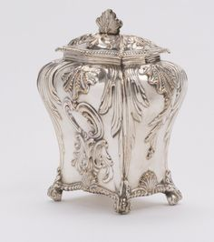 An early Old Sheffield Plate Tea Caddy  By TUDOR & LEADER  circa 1765, // struck with a maker's mark three times, probably for Tudor and Leader. The body engraved with a crest and motto for Clan McIver.  England, c. 1765  //  Sold
