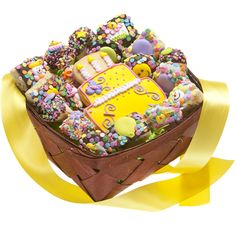 19 Piece Birthday Gift BasketSend Birthday Greetings that they will remember forever! Our Birthday Gift Basket contains 19 delicious hand made cookies with festive sprinkles to brighten up anyones special day!Each Basket Contains:-1 Iced Sugar Shortbread Cookie designed as a festive birthday cake-6 Mini Birthday Rice Krispie Treats-6 Birthday Style Fortune Cookies with Birthday Fortune Messages Inside!-6 Birthday Style OreosBasket is completed with a bright yellow…