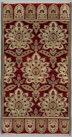 Yastik Cushion Cover  Object Name:     Cushion cover Date:     ca. 1600 Geography:     Turkey, Bursa Culture:     Islamic Medium:     Silk, cotton, metal wrapped thread; cut and voided velvet (çatma), brocaded Dimensions:     Textile a: H. 50 in. (127 cm) W. 26 1/2 in. (67.3 cm) Textile b: H. 50 1/2 in. (128.3 cm) W. 26 1/2 in. (67.3 cm) Mount: H. 53 3/4 in. (136.5 cm) W. 30 1/4 in. (76.8 cm) D. 2 1/4 in. (5.7 cm)  Classification:     Textiles