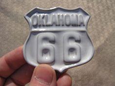 White Sand-glazed Frankoma emblem denoting Route 66 in Oklahoma. Sapulpa, Okla., home to Frankoma Pottery, was situated on the Route 66 highway.  http://www.pinterest.com/mrsbirdswords/frankoma/: