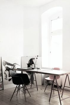 Love this space... the desk, the chairs, the art on the floor.