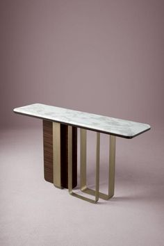 """A rigorous geometry defines the """"statement"""" base of the Saint-Germain console, which is both functional and decorative in equal measure. Designed by Massimiliano Raggi"""