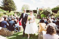 Images by Lemonade Pictures - Bespoke Tea Length Wedding Dress for an outdoor ceremony & rustic barn reception with hand sewn floral bridesmaid dresses and DIY decor.