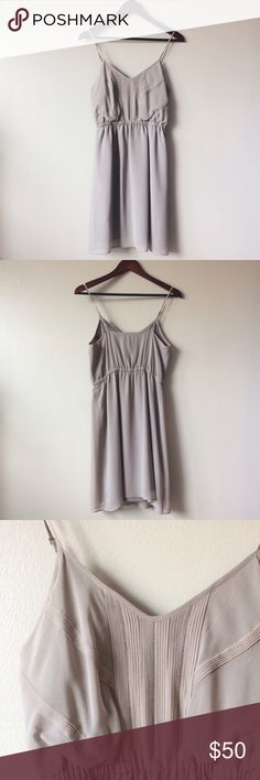 🆕Madewell dress An elegant dress in a gorgeous light taupe color. Features adjustable straps and elasticated waist. Pull on style. Purchased from Madewell.  Shell: 100% silk Lining: 100% polyester   A couple loose threads (only apparent upon close inspection), otherwise excellent condition. Madewell Dresses