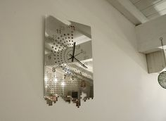 When a mirror steel wall-clock reflects the time passing by...
