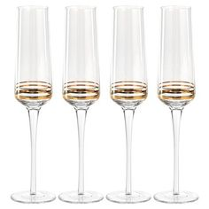Shop the Lola Modern Classic Champagne Flutes with Gold Swirl Detail- Set of 4 and other Glassware at Kathy Kuo Home Flute Glasses, Champagne Glasses, Modern Classic, Entertaining, Detail, Kitchen Tools, Gold, Essentials, Cupcakes