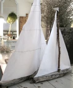 Driftwood sailboats. Cute for kiddos.