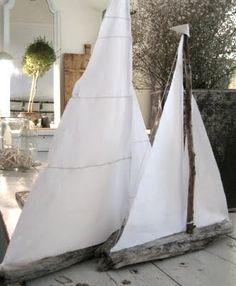 Driftwood sailboats. Cute for kiddos.