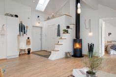 Minimalist Swedish Home with Modern White Interior Theme: Unique Modern Apartment Design Interior With Contemporary Small Fireplace And Wood. Cozy Apartment Decor, Small Apartment Design, Attic Apartment, Small Apartments, Small Spaces, Bohemian Apartment, Apartment Entrance, Attic Renovation, Attic Remodel