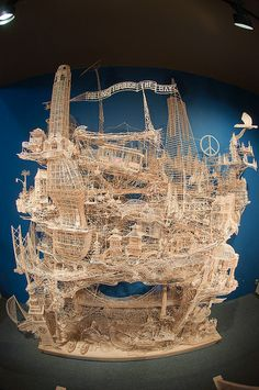 The world's largest kinetic toothpick sculpture, 'Rolling Through the Bay', is not just a standard work of art. It took sculptor Scott Weaver 3,000 hours and 100,000 toothpicks to construct it. Those 3,000 hours were also distributed over 34 years, making this a life's work! The only other material used was Elmer's Glue.