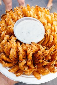 Blooming Onion and Dipping Sauce Recipe. I've seen lots of these recipes, I suppose what I need is another trip back to the States so I can have the real thing. I Love Food, Good Food, Yummy Food, Tasty, Finger Food Appetizers, Appetizer Recipes, Great Recipes, Favorite Recipes, Snacks