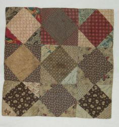 """Diamond in the Square doll quilt, DAR Museum, 15.5"""" square, 1880-1890 (date finished), 9 blocks, each 5"""" x 5""""; binding - edges turned, no separate binding, no filling, tied or tufted and quilted in the ditch"""