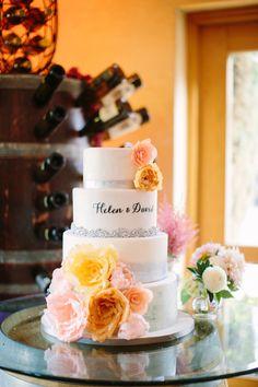 wedding cake with the couple's name - photo by Shane and Lauren Photography http://ruffledblog.com/romantic-temecula-wedding-with-vintage-books #weddingcake #cakes